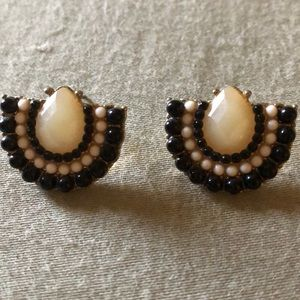 Stud earrings. Black and cream